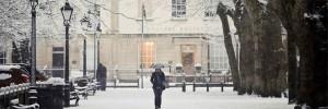 Woman walks through snow