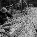 A man building a dry stone wall.