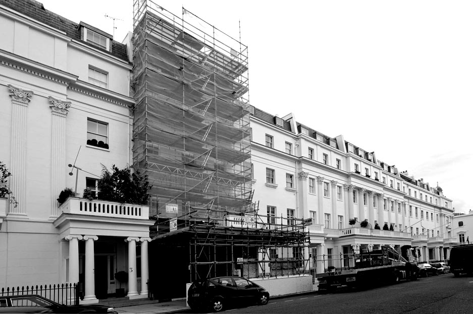 A smart town-house renovation covered with scaffolding.