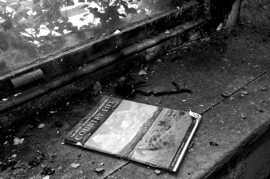 An old copy of Country Life magazine on an old window ledge.